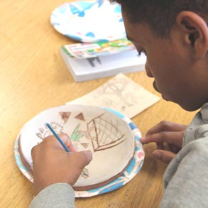 Kid drawing on plate